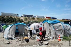 A migrant at a makeshift camp at Calais.