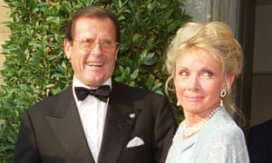 Roger Moore and his wife, Kristina Tholstrup, at a charity event in 2009.