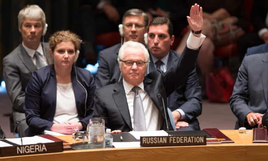 Vitaly Churkin, Russia's permanent representative at the UN, votes against the MH17 resolution.