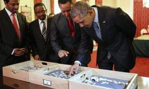 President Barack Obama touches a fossilised vertebra of Lucy, an early human, before a State Dinner in Obama's honour at the National Palace in Addis Ababa.