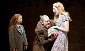 Kerry Ingram (Matilda), Bertie Carvel (Miss Trunchbull) and Lauren Ward (Miss Honey) in Matilda, A Musical