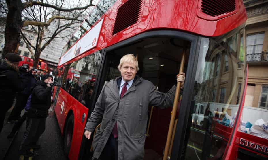 "Mayor Boris Johnson travels on the ""New Routemaster"" bus in December 2011. The design mimics features of the iconic red Routemaster."