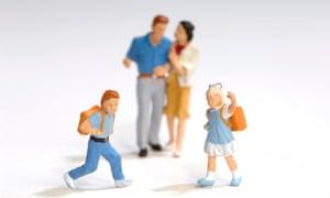 plastic figurines of parents and children