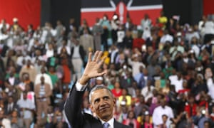 Barack Obama waves to the crowd as he departs the indoor stadium in Nairobi 26 July.