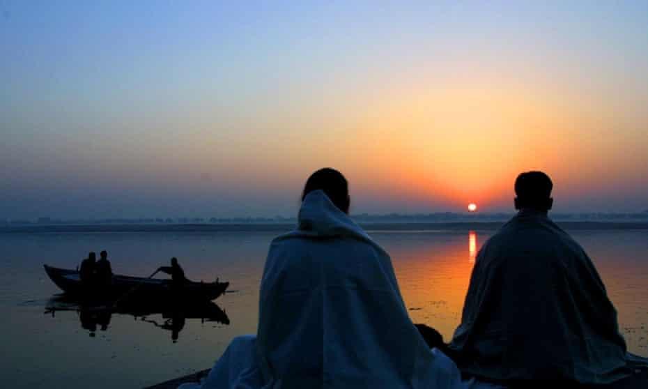 people meditating by river ganges