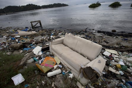 A discarded sofa litters the shore of Guanabara Bay in Rio de Janeiro.