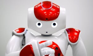 A NAO humanoid robot, developed by Softbank Corp. subsidiary Aldebaran Robotics SA, performs during a demonstration in Tokyo, Japan, on Wednesday, Jan. 28, 2015. Mitsubishi UFJ Financial Group Inc. unveiled the 58-centimeter (23-inch) humanoid on Monday to improve services for customers in Japan and become the first bank in the world to use robots at branches, it said. Photographer: Kiyoshi Ota/Bloomberg via Getty Images