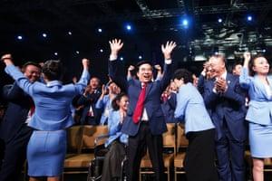 The Beijing delegation celebrates.