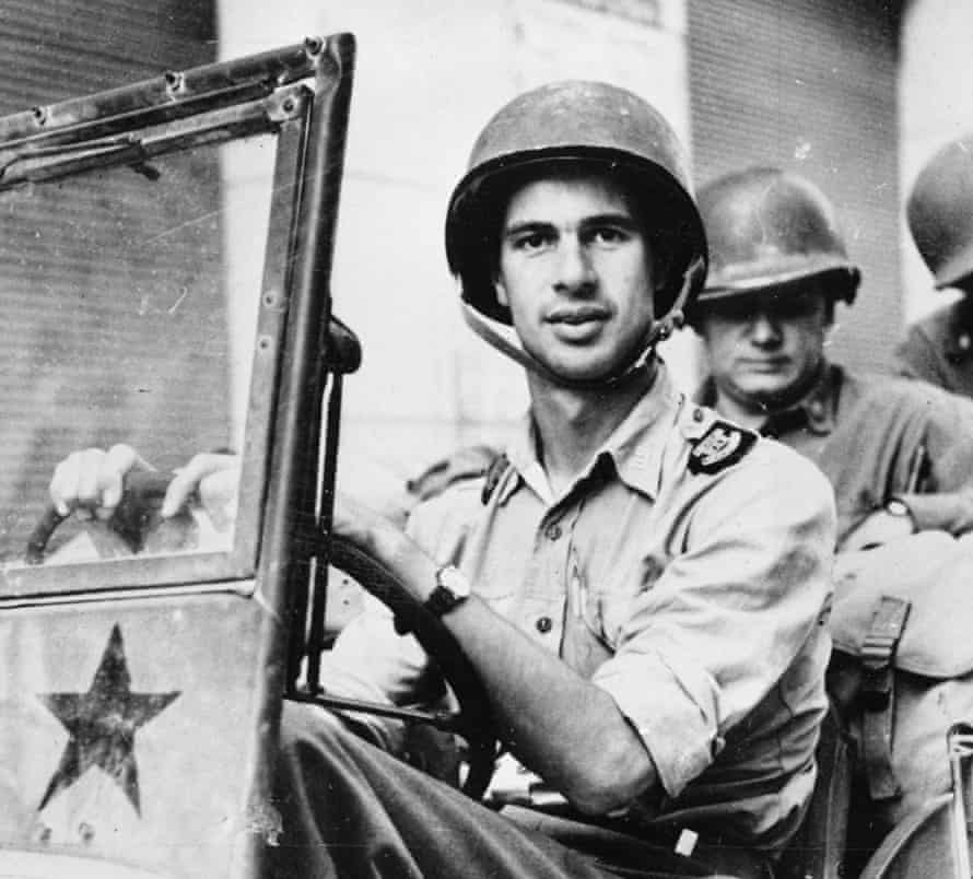 War correspondent John Hersey driving a  US Army jeep in 1944. His acclaimed report on Hiroshima filled an entire issue of the New Yorker.