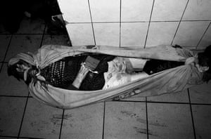 Poldava, 2012: The body of a woman lies on the floor of an overcrowded morgue.