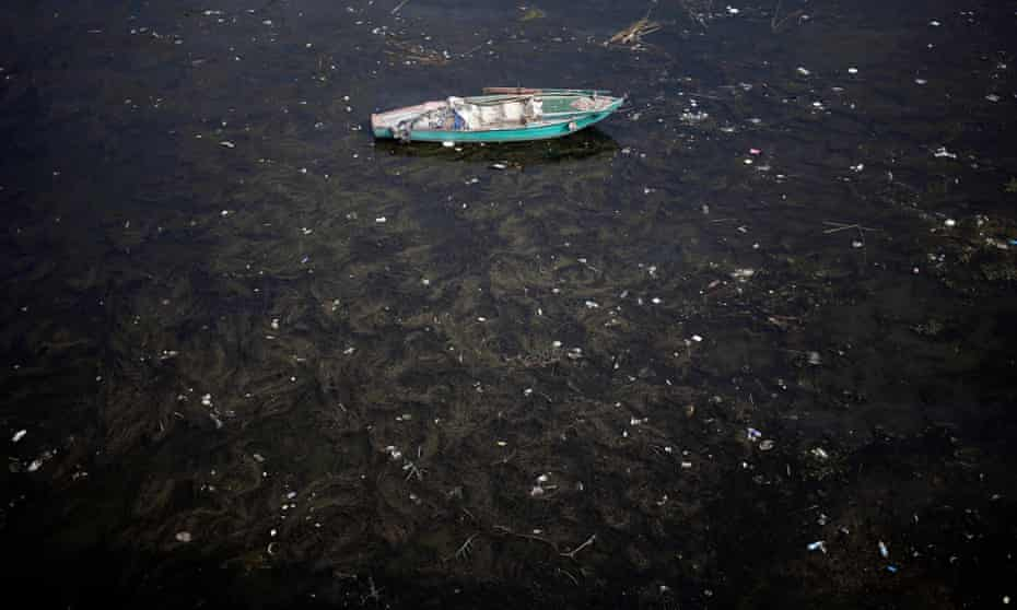 A fishing boat lies anchored in polluted water on the Nile river in Cairo, 2014