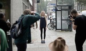 Street-style photographers snap a model