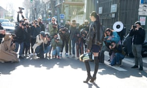 Model Ming Xi with street-style photographers during Paris Collections: Women on March, 2014