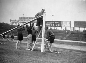 1st August 1935:  Chelsea Football Club players report for training at Stamford Bridge, where their first duty is to erect the goal posts. Chelsea continued to be one of the best supported teams throughout the 1930s. On 12 October 1935, a club record 82,905 attended the match against Arsenal at Stamford Bridge.