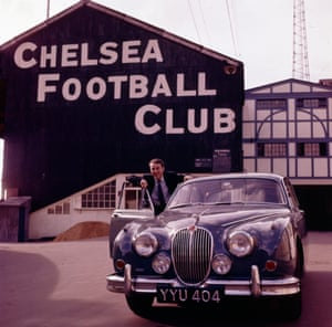 Chelsea's Kings Road became a symbol of the swinging sixties and the mod culture and Steve McQueen, Terence Stamp and Raquel Welsh were regularly seen at Stamford Bridge. Here, in 1965, Jimmy Greaves poses at the door of his Jaguar Mark 2 car outside the stadium.