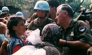 Ratko Mladic organises the expulsion of women and children on July 12, 1995, under the gaze of UN peacekeepers. Srebrenica massacre