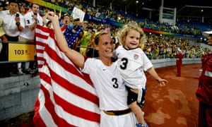 Christie Rampone celebrates Olympic gold with her daughter Rylie in 2008.