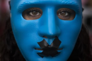 A protester wears a mask with a gag in Madrid, Spain. Thousands of protesters railed against a new public security law nicknamed the 'gag law', branding it legalised muzzling of free expression