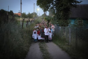 People dressed in traditional clothing celebrate Kupala night in the village of Rakau, 30km west of Minsk in Belarus. People celebrate the holiday with bonfires that last throughout the night, with some leaping over the flames to cleanse themselves of illness and bad luck.