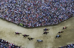 Horses race during the general practice session for the Palio di Siena horse race in Italy, which has been held every 2 July and 16 August since the mid-1600s.
