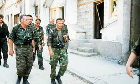 Commander general Ratko Mladic with troops as Bosnian Serbs enter Srebrenica in 1995