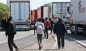 Lorries and migrants in Calais