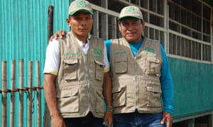 "Ashéninka man Enoc Ruiz Santos and Shipibo man Pedro Monteluisa Romaina at a control post protecting a reserve for indigenous peoples living in ""isolation"" in the Peruvian Amazon."