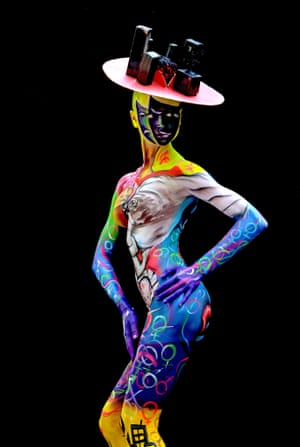 Bodypainting artist Larissa Tulchinski designed this Cubist-inspired painting, adorned with female and male symbols and topped with a striking hat.