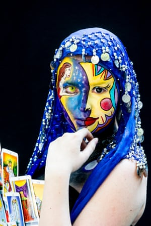 A tarot-inspired design incorporates the model's striking contact lenses as part of the image.