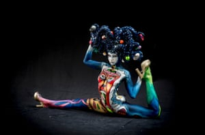 This model poses acrobatically with hair decorated with snooker balls and a rather unsettling image of a jester inside a man's brain.
