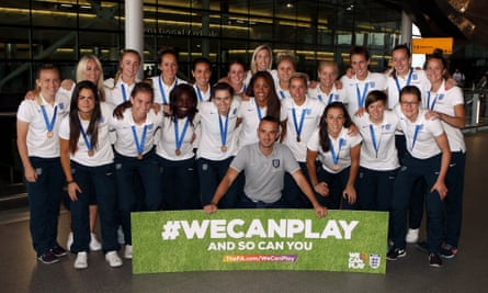 The England team pose at Heathrow after returning from the Women's World Cup