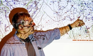 Meteorologist points to a weather map
