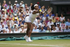 Serena Williams returns with a backhand.