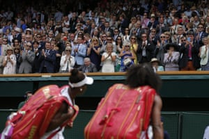 Serena and Venus Williams walk off Centre Court after their match.