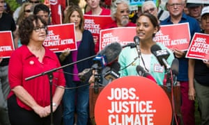 """Protestors argued that climate solutions include an expansion of those sectors of the economy that are already low-carbon, like care-giving and health work. """"As a registered nurse, we see that the damage being done to the climate has and will continue to have a profound effect on global health. Vulnerable populations will be the most affected by climate change – the homeless, Indigenous peoples, those with inadequate housing, and individuals living in coastal regions,"""" said Anastasia Harripaul, with the Registered Nurses of Ontario."""