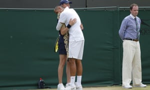 Nick Kyrgios hugs a ballboy during his incident-packed match against Richard Gasquet.