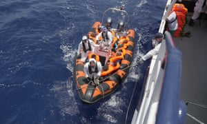 The Migrant Offshore Aid Station's ship, the Phoenix, receives migrants rescued during an attempt to cross the Mediterranean sea.