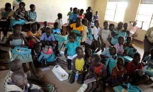 Children sit inside a looted classroom at the Doronj Sown secondary school after renewed conflict in Bor, Jonglei state