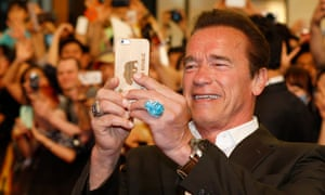 A big ring, but not from the tills …Arnold Schwarzenegger takes a selfie during Terminator Genisys' South Korea premiere.