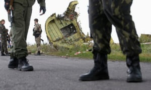 Pro-Russia separatists stand guard at crash site