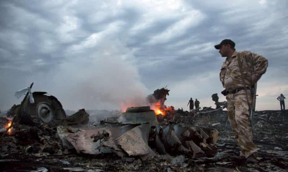 People walk among the plane wreckage