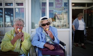 Old women eating ice cream in the heat