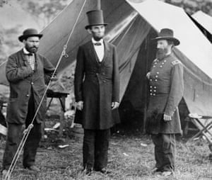 President Abraham Lincoln (C) with Major Allan Pinkerton (L) of the Pinkerton National Detective Agency and General John A McClernand, visiting camp at Sharpsburg, 1862.