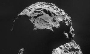 Comet 67P looms in the darkness.