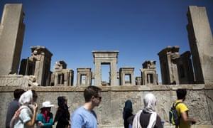 European and Iranian tourists visit the 2,500-year-old Tachara palace at Persepolis in Iran.