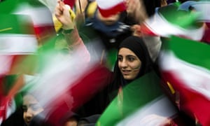 Iranian schoolgirls wave their national flag