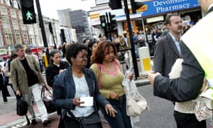 Evacuated tube passengers fill the street at Edgware Road following the explosion