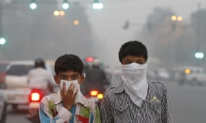 Children cover their face to take precaution from the air pollution in New Delhi. India, alongside Brazil, is among major economies yet to make carbon emissions pledges.