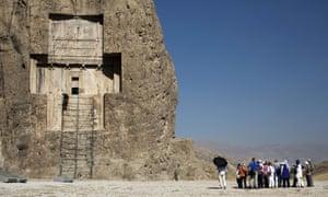 German tourists visit the tomb of Darius I the Great near Persepolis in Iran.