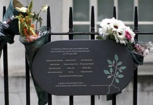 A memorial plaque attached to railings in Tavistock Square.